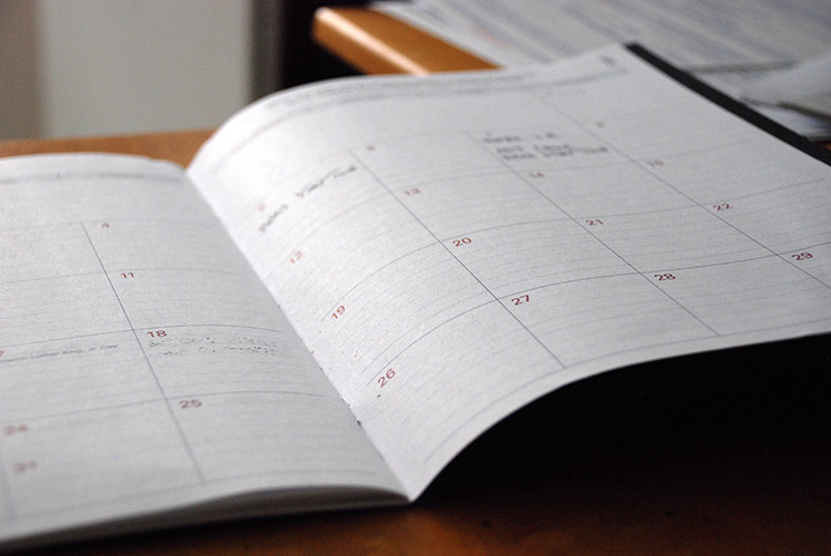 Close up of a calendar used to remember key bookkeeping dates.